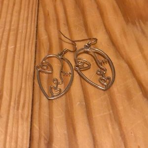 Face dangle earrings